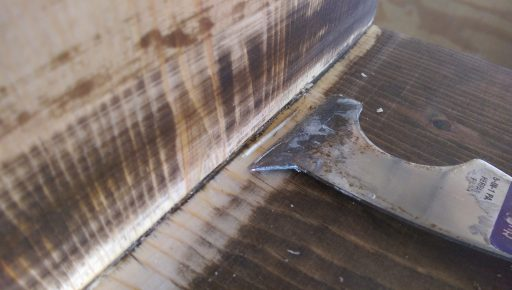 Using 5 in 1 Tool to Scrape Off Glue