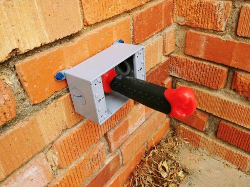 Exterior Outlet: Finishing Hole with Drywall Saw